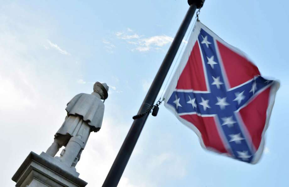 The Confederate flag is seen next to the monument of the victims of the Civil War in Columbia, South Carolina. (AFP / Getty Images) Photo: MLADEN ANTONOV, Staff / AFP