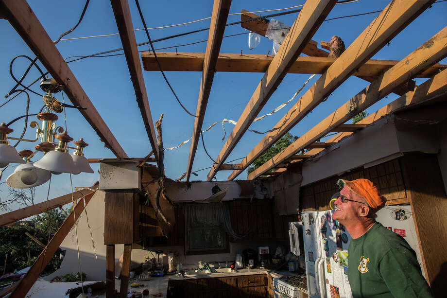 Al Burch examines damage to his kitchen Tuesday after an EF-2 tornado passed through Coal City, Ill. on Monday night, injuring five people.  Photo: Zbigniew Bzdak, MBO / Chicago Tribune