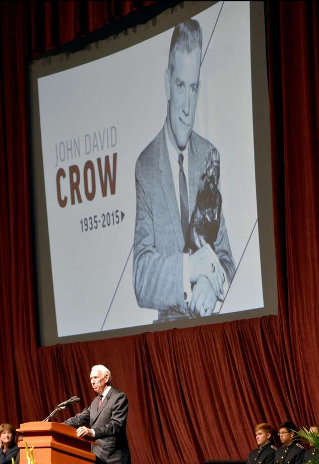 Former Texas A&M football coach R.C. Slocum speaks about his friend and colleague John David Crow during a memorial service for the former Heisman trophy winner on Tuesday, June 23, 2015, at Reed Arena in College Station, Texas. Crow, the bruising running back who won the 1957 Heisman Trophy with Texas A&M before a Pro Bowl career in the NFL died at age 79. (Sam Craft/College Station Eagle via AP) Photo: Sam Craft, Associated Press