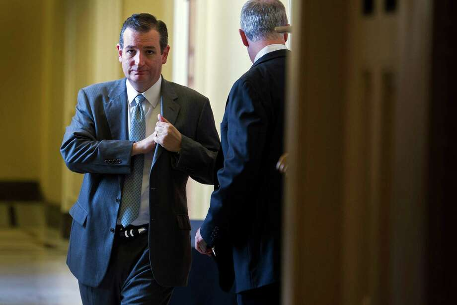 Sen. Ted Cruz, R-Texas,  leaves a policy luncheon at the U.S. Capitol in Washington, Tuesday, June 23, 2015. The Senate pushed bipartisan trade legislation to the brink of final approval Tuesday in a combined effort by President Barack Obama and Republican congressional leaders to rescue a measure that appeared all but dead less than two weeks ago. (AP Photo/Cliff Owen) Photo: Cliff Owen, FRE / Associated Press / FR170079 AP