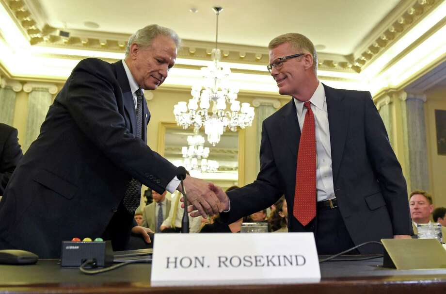National Highway Traffic Safety Administration leader Mark Rosekind, left, greets Department of Transportation Inspector General Calvin Scovel as they arrive to testify Tuesday before the Senate Commerce, Science, and Transportation Committee. Photo: Susan Walsh, STF / AP