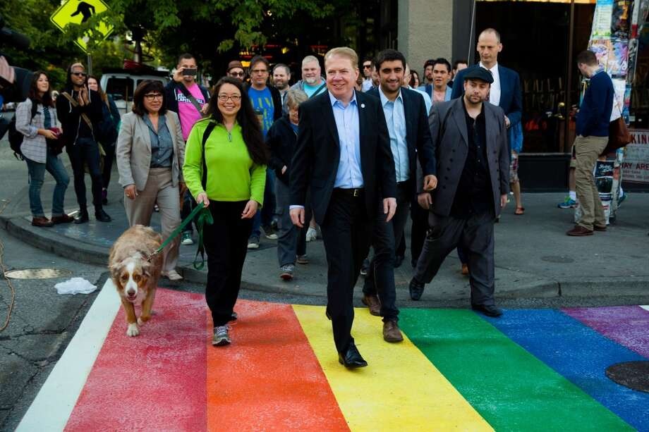 With Seattle's Pride Week kicking off, Mayor Ed Murray, center right, unveiled newly-installed, rainbow-colored crosswalks in various locations around Capitol Hill, photographed Tuesday, June 23, 2015, at the intersection of 10th and Pike Street in Seattle, Washington.  (Jordan Stead, seattlepi.com) Photo: JORDAN STEAD, SEATTLEPI.COM