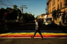 Passerby navigate the newly-installed, rainbow-colored crosswalks in various locations around Capitol Hill, photographed Tuesday, June 23, 2015, at the intersection of 10th and Pike Street in Seattle, Washington. (Jordan Stead, seattlepi.com)