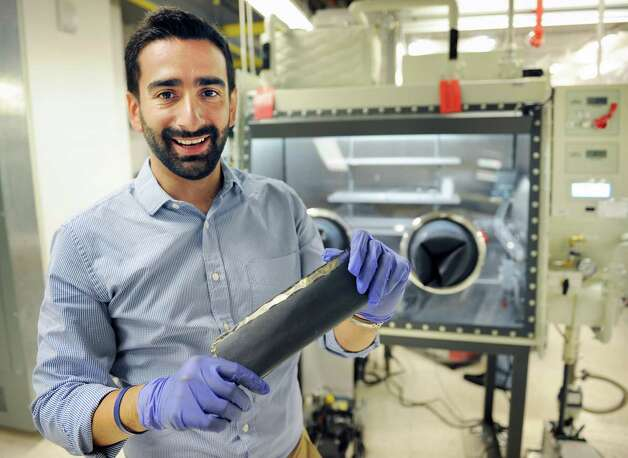 BESS Tech's Fernando Gomez-Baquero holds a silicon anode, a component in their manufacturing of lithium ion batteries in a SUNY Poly campus lab at CNSE Tuesday June 23, 2015 in Albany, NY.  (John Carl D'Annibale / Times Union) Photo: John Carl D'Annibale / 00032365A