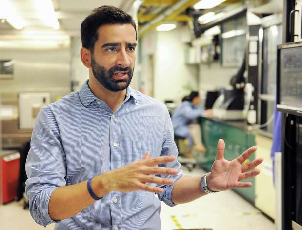 Fernando Gomez-Baquero of BESS Tech's discusses battery technology in a lab at the SUNY Poly campus Tuesday June 23, 2015 in Albany, NY.  (John Carl D'Annibale / Times Union) Photo: John Carl D'Annibale / 00032365A