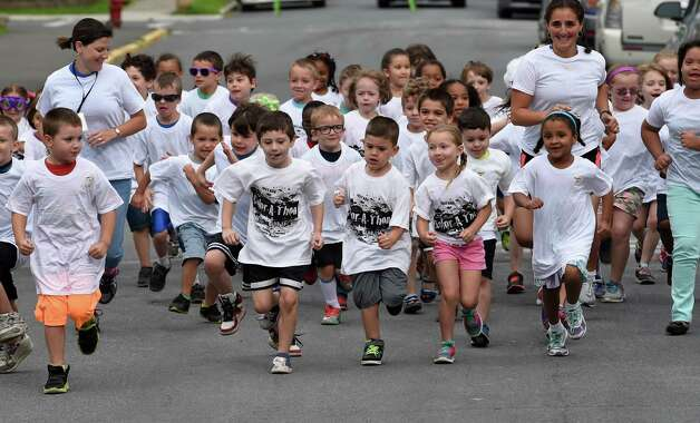 Kindergartners and first graders start the Color-a-thon,  running race as part of the final days of school Tuesday morning, June 23, 2015, at School 16 in Troy, N.Y.  The event was  fundraiser for the PTA.   (Skip Dickstein/Times Union) Photo: SKIP DICKSTEIN / 00032326A