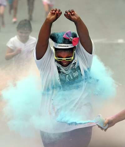 Sara Watson gets some blue on as she passes the finish line in the Color-a-thon, running race as part of the final days of school Tuesday morning, June 23, 2015, at School 16 in Troy, N.Y.  The event was  fundraiser for the PTA.   (Skip Dickstein/Times Union) Photo: SKIP DICKSTEIN / 00032326A