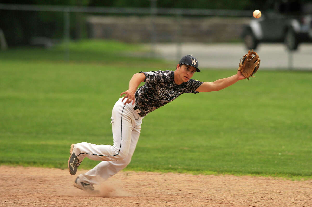Westport shortstop Marco Latella reaches for a ball hit up the middle during the Wreckers' Senior Legion baseball game against Greenwich at Julian Curtiss School in Greenwich, Conn., on Tuesday, June 23, 2015.