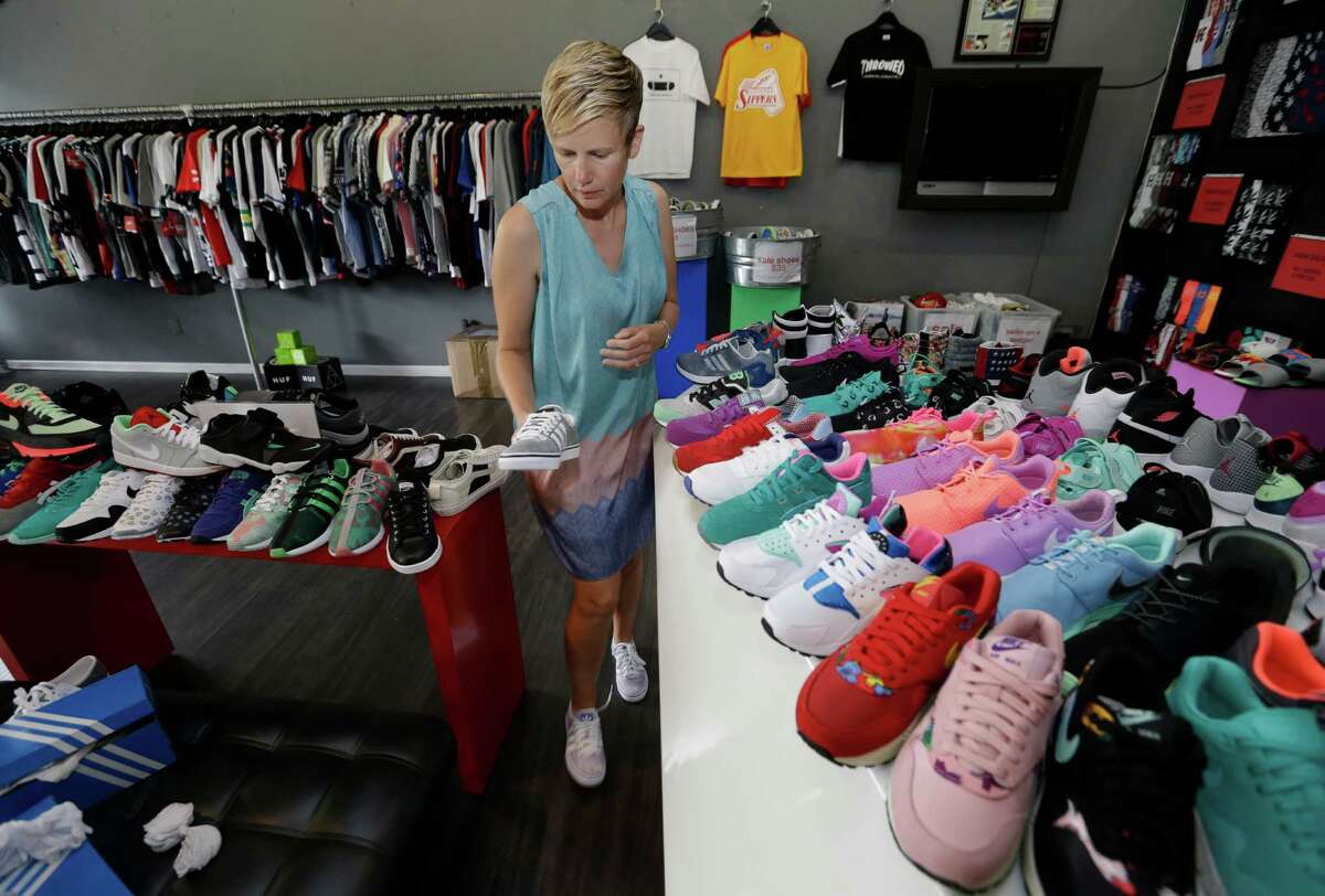 Customer Wendy Orth shops for shoes at Premium Goods, 2416 Times Boulevard, Tuesday, June 23, 2015, in Houston. ( Melissa Phillip / Houston Chronicle )