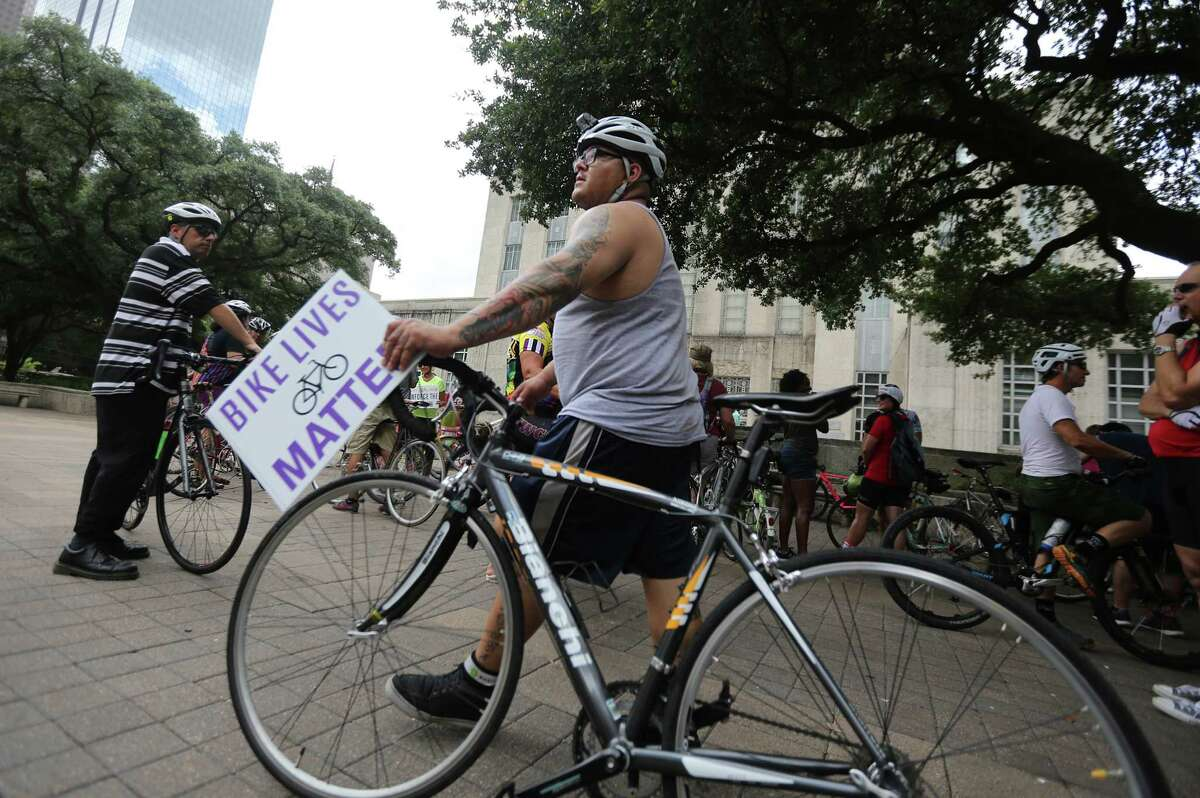 (right) Ricardo Martinez joins cyclist in a silent protest outside City Hall to remind motorist to share the road with cyclist on Tuesday, June 23, 2015, in Houston. In the past three weeks, there have been 4 bicycle related fatalities in Houston. Three of those deaths were at the hands of someone driving a car. The fourth one was cause by debris leading to a crash on the Elysian Bridge.