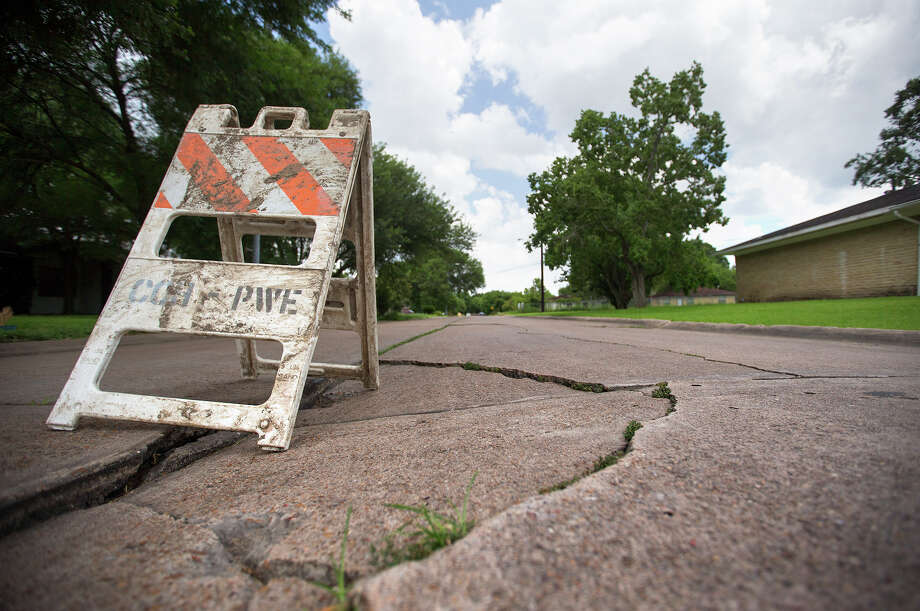 City residents who have waited for their crumbling roads to be improved could be out of luck as a lawsuit against the ReBuild program is argued in court. Photo: Cody Duty, Staff / © 2015 Houston Chronicle