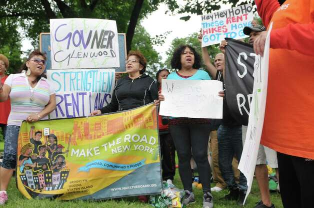 New York City tenants and advocates chant as they hold a rally in Academy Park after sleeping in the park overnight on Tuesday, June 23, 2015, in Albany, N.Y. The group is calling on the governor and legislators to strengthen rent laws and end deregulation and eliminate the loopholes that have allowed rents to skyrocket.    (Paul Buckowski / Times Union) Photo: PAUL BUCKOWSKI / 00032370A
