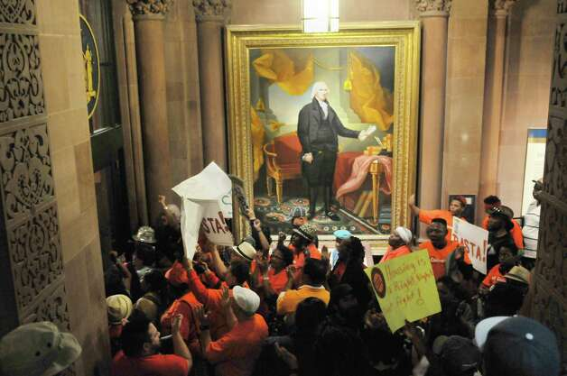New York City tenants and advocates chant as they block the entrance to Governor Cuomo's offices at the Capitol on Tuesday, June 23, 2015, in Albany, N.Y. The group is calling on the governor and legislators to strengthen rent laws and end deregulation and eliminate the loopholes that have allowed rents to skyrocket.    (Paul Buckowski / Times Union) Photo: PAUL BUCKOWSKI / 00032370A