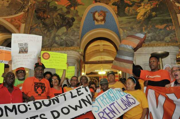 New York City tenants and advocates chant as they hold a rally inside the Capitol on Tuesday, June 23, 2015, in Albany, N.Y. The group is calling on the governor and legislators to strengthen rent laws and end deregulation and eliminate the loopholes that have allowed rents to skyrocket.    (Paul Buckowski / Times Union) Photo: PAUL BUCKOWSKI / 00032370A