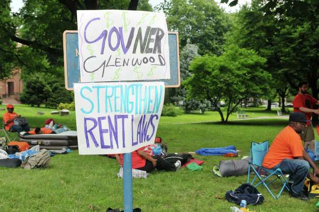 New York City tenants and advocates who slept out in Academy Park across the street from the Capitol, hang out in the park after waking up on Tuesday, June 23, 2015, in Albany, N.Y. The group is calling on the governor and legislators to strengthen rent laws and end deregulation and eliminate the loopholes that have allowed rents to skyrocket.    (Paul Buckowski / Times Union) Photo: PAUL BUCKOWSKI / 00032370A