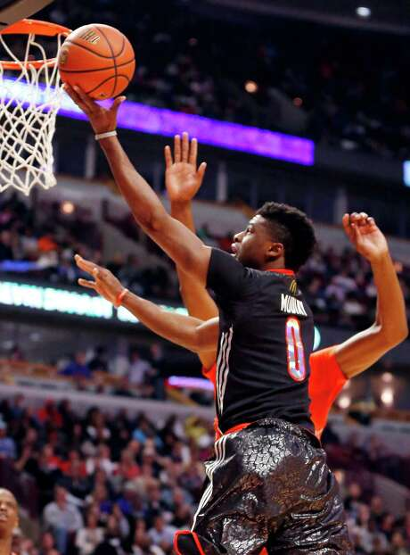 Emmanuel Mudiay (0) is an example of the international reach of basketball. He was born in the Congo, went to high school in the United States, and played professionally in China while awaiting a chance to enter the NBA draft, where he'll likely be a top-10 pick. Photo: Charles Rex Arbogast, STF / AP