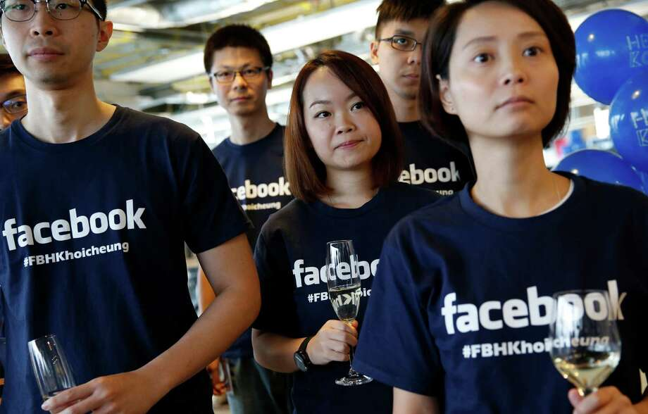 Facebook staffers attend the 2014 opening of their office in Hong Kong. The online social network has knocked Wal-Mart out of the top 10 list of the highest-valued companies in the Standard & Poor's 500 index. Photo: Kin Cheung, STF / AP