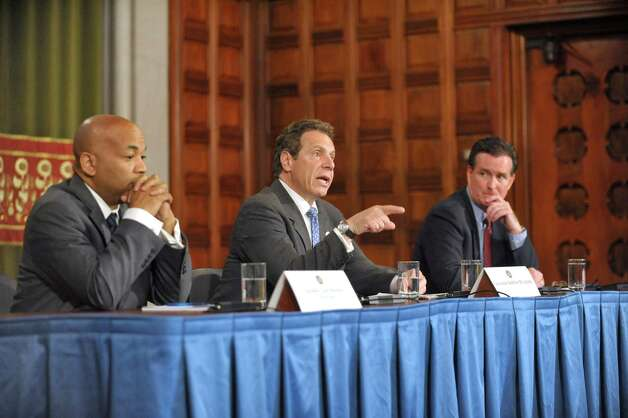 New York State Assembly Leader Carl Heastie, left, Governor Andrew Cuomo, center, and New York Senate Majority Leader John Flanagan take part in a press conference at the Capitol where the three announced that they have reached a framework deal on Tuesday, June 23, 2015, in Albany, N.Y.   (Paul Buckowski / Times Union)      (Paul Buckowski / Times Union) Photo: PAUL BUCKOWSKI / 00032366A