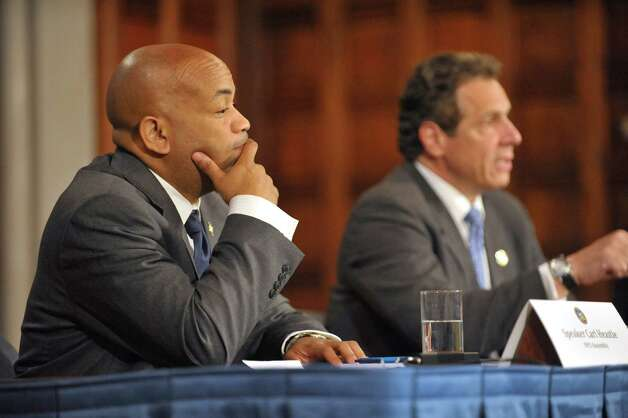 New York State Assembly Leader Carl Heastie, left, listens as Governor Andrew Cuomo, right, answers a question during a press conference at the Capitol on Tuesday, June 23, 2015, in Albany, N.Y.   (Paul Buckowski / Times Union)      (Paul Buckowski / Times Union) Photo: PAUL BUCKOWSKI / 00032366A