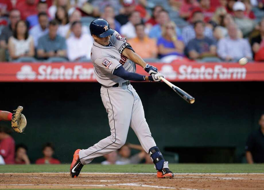 Carlos Correa connects on a three-run homer in the second inning that helped the Astros to a big early lead that was never threatened Tuesday. Photo: Jae C. Hong, STF / AP