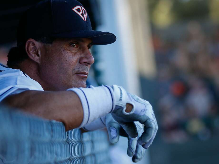 Former MLB star Jose Canseco watches first inning action from the Pittsburg Diamonds dugout during a game at City Park in Pittsburg, California, on Tuesday, June 23, 2015. Canseco batted as designated hitter for the Diamonds in the game against the San Rafael Pacifics. Photo: Loren Elliott, The Chronicle
