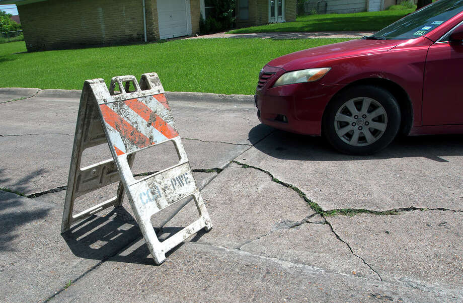 A car drives past a public works sign in the middle of Jutland Road in June.State Sen. Paul Bettencourt, a Houston Republican who led the effort to sue the city over ReBuild, said the city jeopardized the fee by failing to be honest with voters. Photo: Cody Duty, Houston Chronicle / © 2015 Houston Chronicle