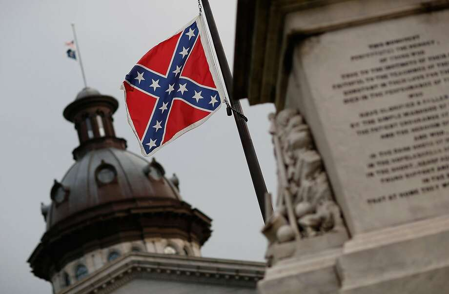 The Confederate flag flies on the Capitol grounds one day after South Carolina Gov. Nikki Haley announced that she will call for the Confederate flag to be removed on June 23, 2015 in Columbia, South Carolina.  Photo: Win McNamee, Getty Images