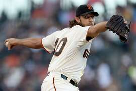 SAN FRANCISCO, CA - JUNE 23:  Madison Bumgarner #40 of the San Francisco Giants pitches against the San Diego Padres in the top of the first inning at AT&T Park on June 23, 2015 in San Francisco, California.  (Photo by Thearon W. Henderson/Getty Images)