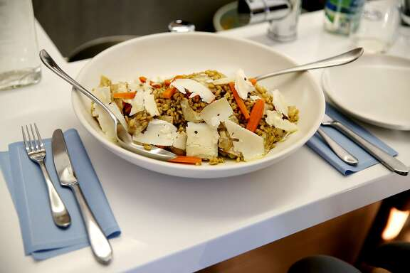 A farro salad with lemon vinagrette, pickled carrots, artichoke and Bellwether Farms pepato cheese served as the first dish of a Kitchit Tonight dinner in San Francisco, California, on Monday, June 22, 2015. Kitchit Tonight is a service where a chef comes to a person's home and cooks a three-course meal for a party of up to 12 people.