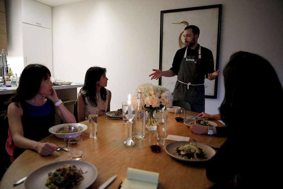Andrew Menard describes the food he just prepared for this Kitchit Tonight dinner in San Francisco. Photo: Connor Radnovich, The Chronicle