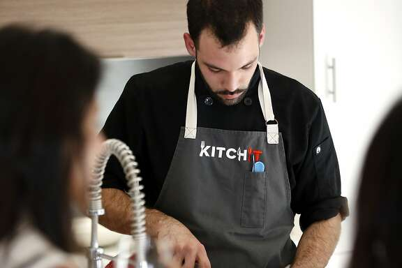 Andrew Menard prepares the first course during a Kitchit Tonight dinner in San Francisco, California, on Monday, June 22, 2015. Kitchit Tonight is a service where a chef comes to a person's home and cooks a three-course meal for a party of up to 12 people.