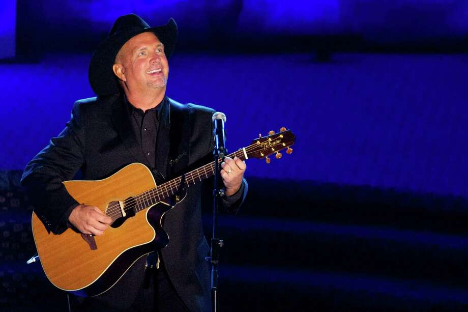 Inductee Garth Brooks performs onstage at the 42nd Annual Songwriters Hall of Fame Awards in New York, Thursday, June 16, 2011. (AP Photo/Charles Sykes) Photo: Charles Sykes, FRE / FR170266 AP