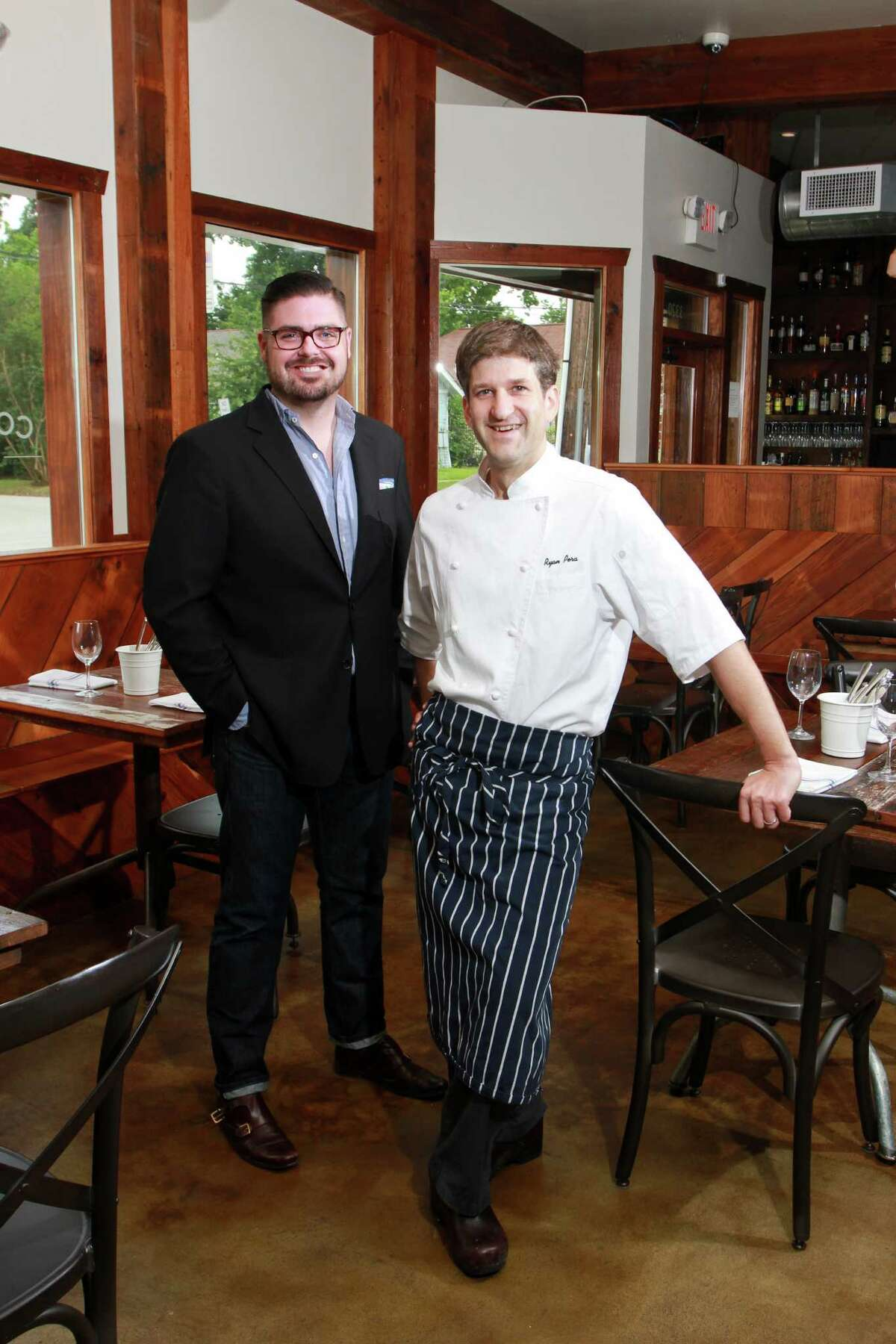 (For the Chronicle/Gary Fountain, May 9, 2014) Co-owners Morgan Weber, left, and Ryan Pera at Coltivare, 3320 White Oak in the Heights.