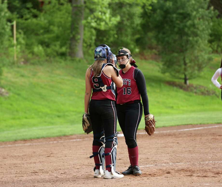 Noelle (9) and Marissa (16) Ruschil have a conference in the circle. Freshman Noelle hit .583 in the postseason, driving in three while Marissa hit .600 with four RBIS. Photo: Contributed / New Canaan News