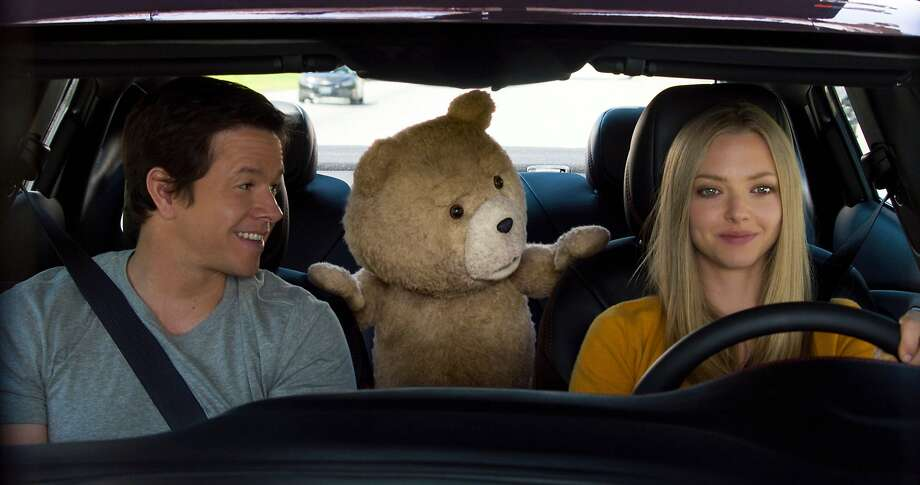 "In this image released by Universal Pictures, Mark Wahlberg , from left, the character Ted, voiced by Seth MacFarlane, and Amanda Seyfried appear in a scene from ""Ted 2."" (Universal Pictures via AP) Photo: Associated Press"
