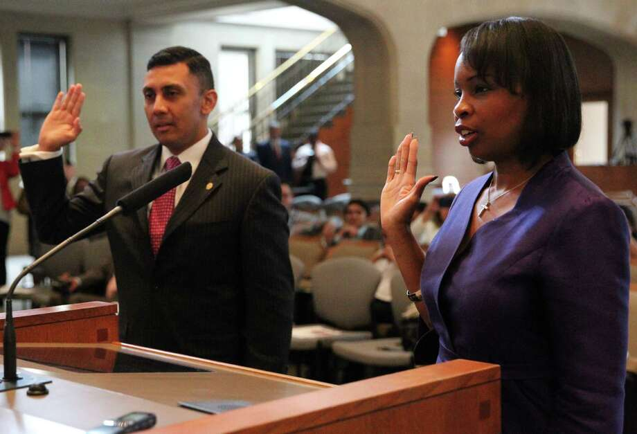 Cris Medina, left, and Ivy Taylor are sworn in as a new City Council member and Mayor of San Antonio respectively on Wednesday June 24, 2015 in the City Council chamber. Photo: Tom Reel / San Antonio Express-News