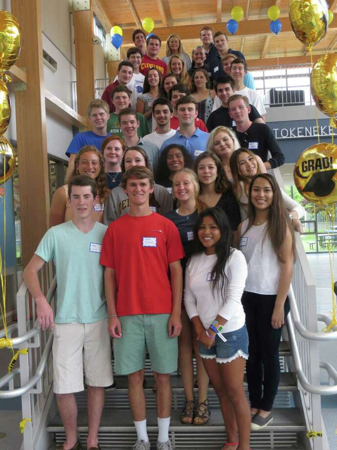 Recent Darien High School graduates returned to Tokeneke Elementary School for a recent visit. Photo: Contributed Photo / Darien News