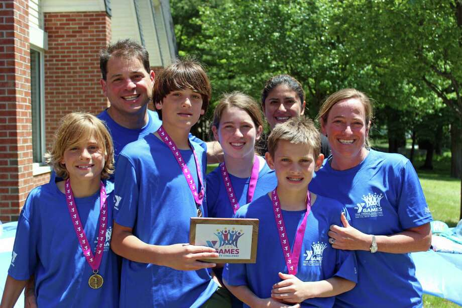 The two winning Family Division teams that tied for first place, left to right back row: Nick Branca, Lybia Sanabria. Left to right front row: Tommy Branca, Cole Branca (holding the award donated by Chocolate Works Darien), Libby Branca, Billy Branca and Stacy Branca. Photo: Contributed / Darien News
