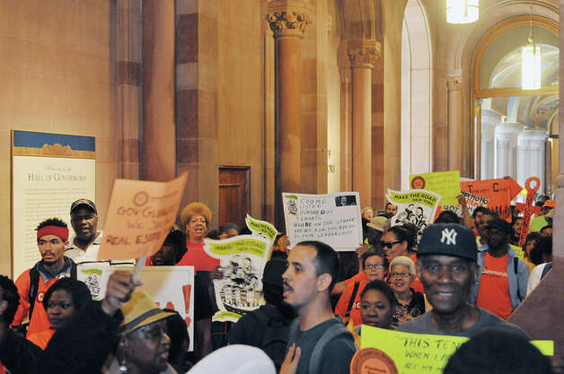 New York City tenants and advocates chant as they block the entrance to Governor Cuomo's offices at the Capitol on Tuesday, June 23, 2015, in Albany, N.Y. The group is calling on the governor and legislators to strengthen rent laws and end deregulation and eliminate the loopholes that have allowed rents to skyrocket.    (Paul Buckowski / Times Union) Photo: PAUL BUCKOWSKI, Albany Times Union / 00032370A