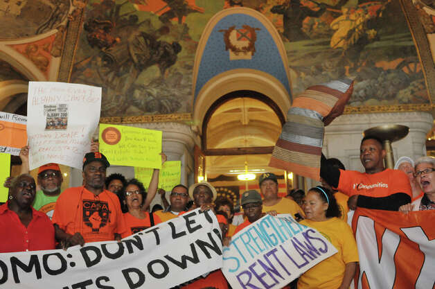 New York City tenants and advocates chant as they hold a rally inside the Capitol on Tuesday, June 23, 2015, in Albany, N.Y. The group is calling on the governor and legislators to strengthen rent laws and end deregulation and eliminate the loopholes that have allowed rents to skyrocket.    (Paul Buckowski / Times Union) Photo: PAUL BUCKOWSKI, Albany Times Union / 00032370A