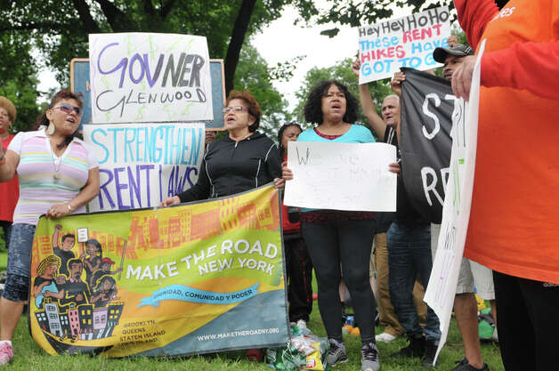 New York City tenants and advocates chant as they hold a rally in Academy Park after sleeping in the park overnight on Tuesday, June 23, 2015, in Albany, N.Y. The group is calling on the governor and legislators to strengthen rent laws and end deregulation and eliminate the loopholes that have allowed rents to skyrocket.    (Paul Buckowski / Times Union) Photo: PAUL BUCKOWSKI, Albany Times Union / 00032370A