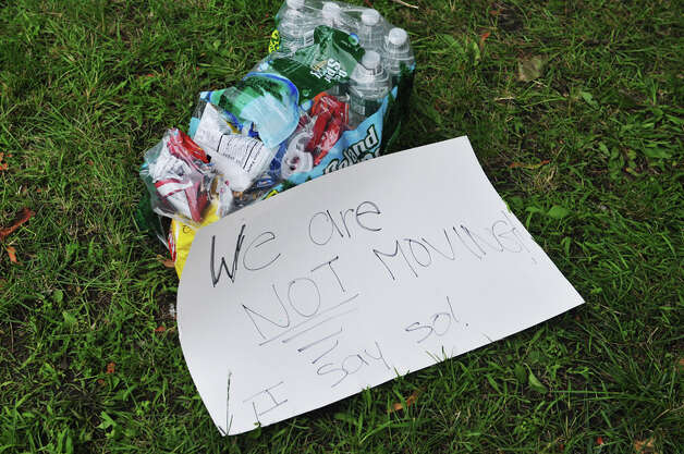 Bottles of water, bags of snacks and a sign are seen on the ground in Academy Park on Tuesday, June 23, 2015, in Albany, N.Y., where New York City tenants and advocates slept overnight. The group is calling on the governor and legislators to strengthen rent laws and end deregulation and eliminate the loopholes that have allowed rents to skyrocket.    (Paul Buckowski / Times Union) Photo: PAUL BUCKOWSKI, Albany Times Union / 00032370A