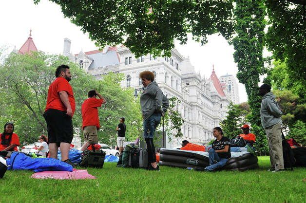 New York City tenants and advocates who slept out in Academy Park across the street from the Capitol, hang out in the park after waking up on Tuesday, June 23, 2015, in Albany, N.Y. The group is calling on the governor and legislators to strengthen rent laws and end deregulation and eliminate the loopholes that have allowed rents to skyrocket.    (Paul Buckowski / Times Union) Photo: PAUL BUCKOWSKI, Albany Times Union / 00032370A