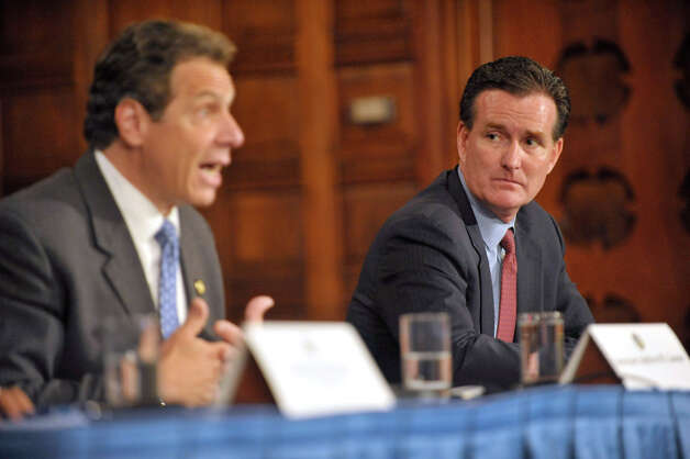 New York Senate Majority Leader John Flanagan, right, listens as Governor Andrew Cuomo, right, answers a question during a press conference at the Capitol on Tuesday, June 23, 2015, in Albany, N.Y.   (Paul Buckowski / Times Union) Photo: PAUL BUCKOWSKI, Albany Times Union / 00032366A