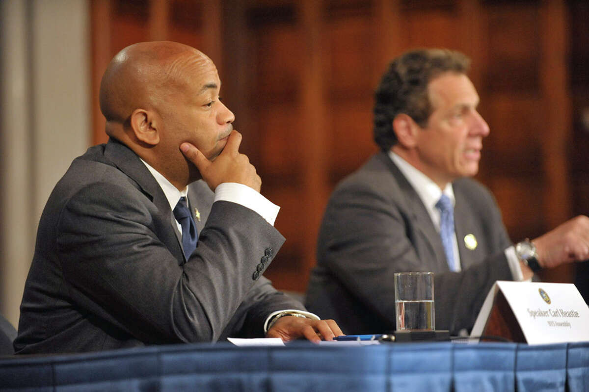 New York State Assembly Leader Carl Heastie, left, listens as Governor Andrew Cuomo, right, answers a question during a press conference at the Capitol on Tuesday, June 23, 2015, in Albany, N.Y. (Paul Buckowski / Times Union) (Paul Buckowski / Times Union)