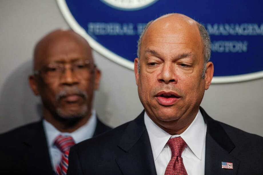 Homeland Security Secretary Secretary Jeh Johnson, right, announced changes Wednesday to the Obama administration's family dentention policy. Photo: Zach Gibson /Associated Press / FR170359 AP