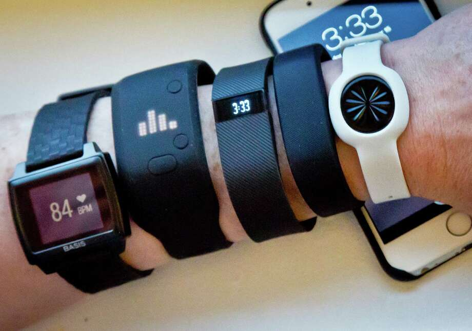 Sales of fitness trackers are climbing, but so far the only studies on their effectiveness have been limited. Part of their promise lies in how they could change the way people think about their  habits and their approach to health. Photo: Bebeto Matthews /Associated Press / AP