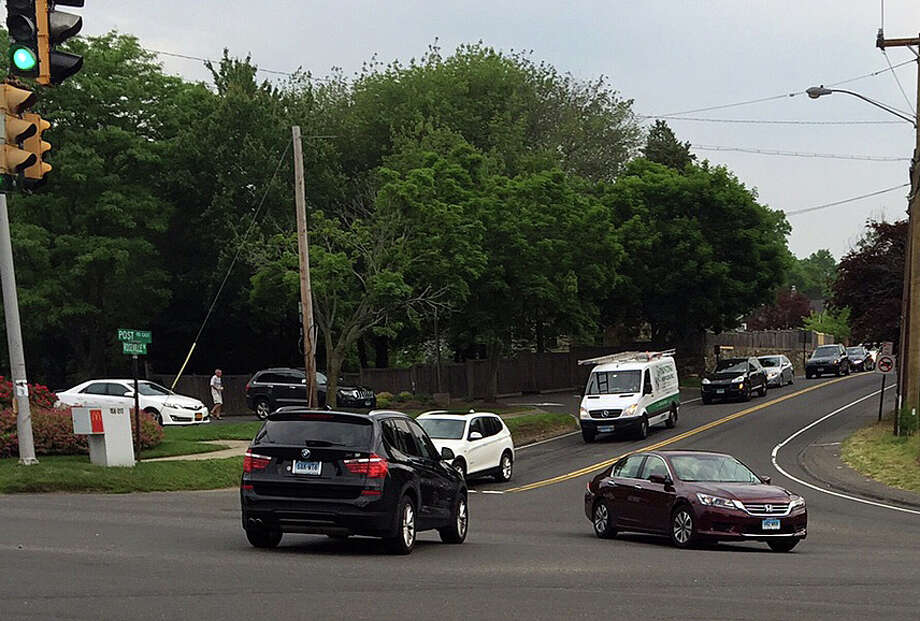"""Another near miss at the """"bumper-cars"""" intersection of Post Road East and Hillspoint/Roseville roads. """"Everybody hates to wait,"""" writes commentator Arthur Hayes. """"But you just have to, or someday, the right side of your shiny new Tesla is going to meet the front end of my slightly rusty 13-year-old Jeep Wrangler. And when that happens, you will have to pay to fix my 13-year-old rusty bumper."""" Photo: Arthur Hayes / Contributed Photo / Westport News"""