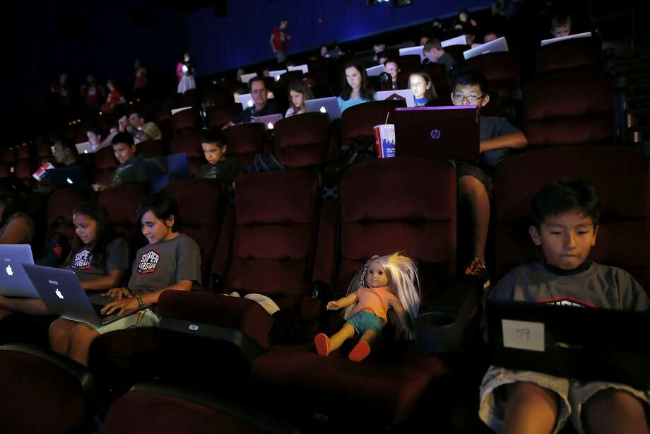 More than 50 children and parents took part in a game of Minecraft in a movie theater in Redwood City, California, on Tuesday, June 23, 2015. The event was put on by Super League Gaming as a demo of a league they want to launch in September. Photo: Connor Radnovich, The Chronicle