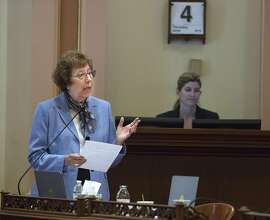 """Sen. Lois Wolk, D-Davis, asks members to vote """"Yes"""" on  SB128 a bill that would shield doctors from prosecution if they give terminally ill adults the option of medical aid in dying, Thursday, June 4, 2015. The bill passed and will now move to the Assembly. (Hector Amezcua/Sacramento Bee via AP)  MAGAZINES OUT; LOCAL TELEVISION OUT (KCRA3, KXTV10, KOVR13, KUVS19, KMAZ31, KTXL40); MANDATORY CREDIT"""